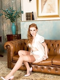 Redhead Alexa strips down to her retro lingerie, pink..