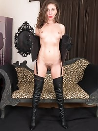 Its a kinky madam Chloe we have here, leather corset and..