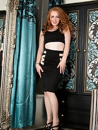 Fair-skinned redhead Tia Jones gets all hot and horny just..