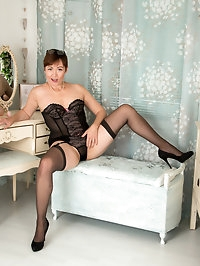 Mature milf Kitty Creamer may dress like a lady when she..