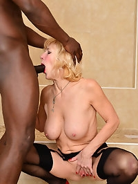 Blonde MILF Molly Maracas enjoys a steamy interracial..