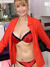 Mature babe Jane B rocking in red