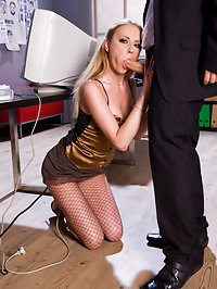 A secretary in fishnet pantyhose fucking a guy at the office