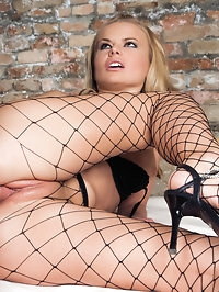 She is a sexy minx in her fishnet tights fucking a hard cock