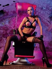 Wild babe in leather fucking two guys on the fetish chair