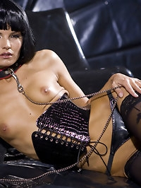 Wild fetish sexy babe posing in leather and black stockings