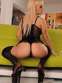 Blonde beauty with high heels and stockings shows great ass