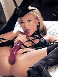 Japanese beauty playing with some big dildos and strap on