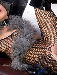 Two fetish lesbian babes in fishnet lick and suck each other