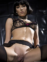 Brunette in black lingerie shows great ass and nice boobs