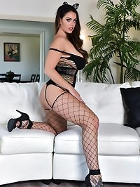 Sexy Alison on a white couch
