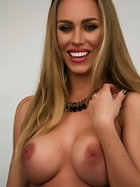 Sexy Nicole Aniston on a white bed