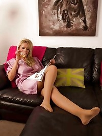 Sexy housewife is restrained in her living room and teased..