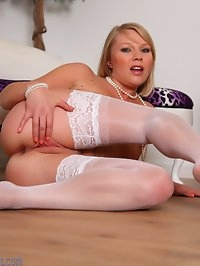 Abigail Toyne in white lace and nylon lingerie