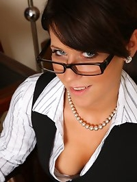 Secretary Lilly in glasses strips to her tan holdups for..