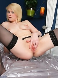 First timer Tegan strips to her stockings to finger her..