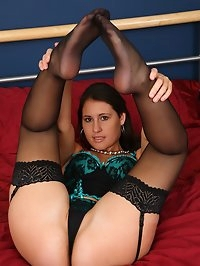 Jess in stockings and basque fingering her horny pussy