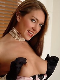 Elen is stunning in her basque, stockings and sexy gloves