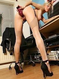 Secretary Harmony playing with her dildo at her desk