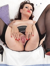 Naughty temptress playing with herself