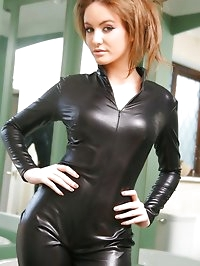 Kinky brunette flaunts her sexy curves in a skin tight..