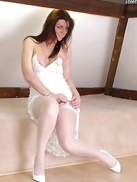 Jackie in white patent heels and white stockings