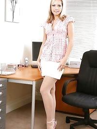 Beautiful blonde strips out of the miniskirt and stays in..