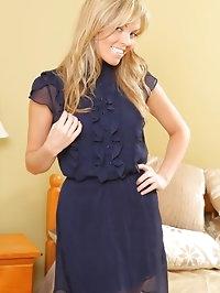 Stunning secretary in a sheer navy minidress, high heels..