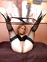 46 year old blonde Tiffany slips a couple fingers into her..