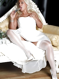 Slutty Lana is wearing a wedding dress and masturbating