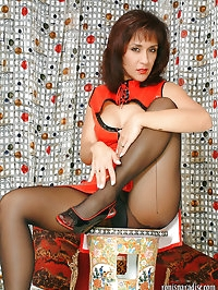 Pretty mom in Japanese clothes showing her pantyhose