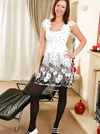 Carole wearing cute black and white dress.