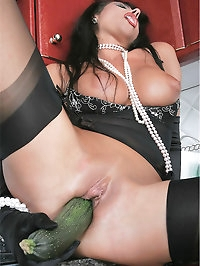 Cutie fucks herself with cucumber
