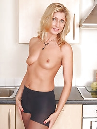 34 year old Yasmin forces a long glass dildo deep inside..