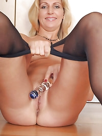 34 year old Yasmin forces a long glass dildo deep inside..