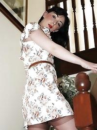 girdled brunette poses on stairs