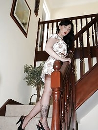 girdled brunette poses on stairs
