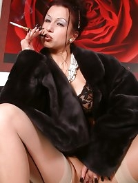 elegant lady smoking in lingerie and stockings