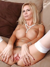 Beautiful blonde Anilos lady shows off her big breasts and..