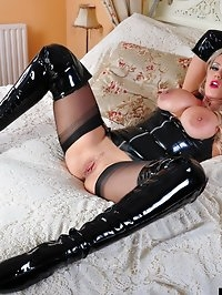 Gorgeous blonde with her hands and feet bound on the bed..