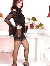 This magnificent brunette mom is in stockings