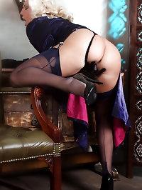 Lana wearing stockings and gloves as she finger fucks her..