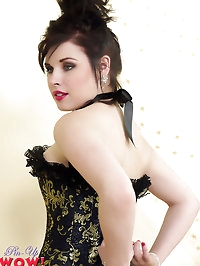 Heavenly brunette model in corset and black seamed..