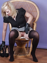 Horny blonde Axajay puts on her black studded leather..