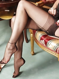 Alina dressed in short dress with stockings and high heels..