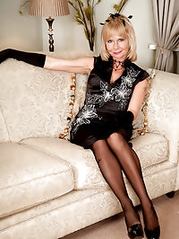Blonde cougar Cathy Oakely wears sexy stockings as she..