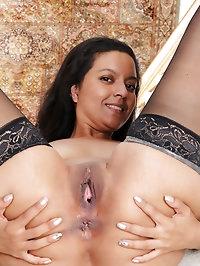 Horny brunette pilot Julie Ann spreading her shaven pussy..