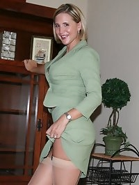 Desirae stripping out of business suit with stockings
