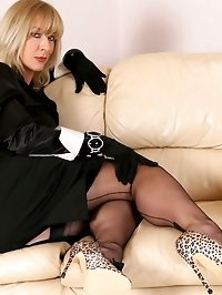 Business woman Astrid strips down to her corset and..