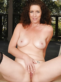 Brunette and lacey Tammy Sue pulls down her pink thong in..